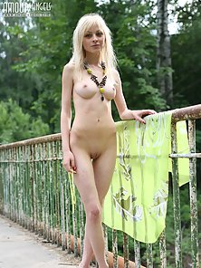 Skinny Slut Exposing Sexual Parts While Standing Outdoors