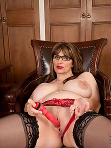 Hot milf busty dame toying with her pussy