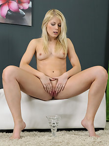 Sizzling Blonde Using Speculum to Spread Pussy for Photoshoot