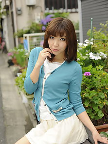 Hot Juri Kitahara posing in her outfit outdoors