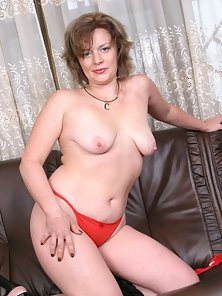 Naughty Mature Shows Her Big Boobs on Bed