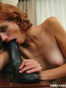 Short Red Haired Skinny Chick Evelyn Rammed By a Massive Black Dildo