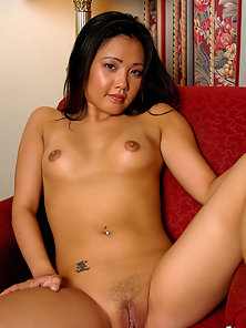 Cute Lynda Nguyen spreading her legs to show her shaved twat