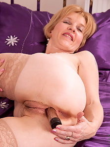 Tattooed Mature Puts Huge Dildo in Tight Muff