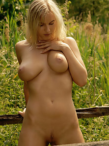 Blonde Female Showing Her Naked Busty Figure in Sexual Position