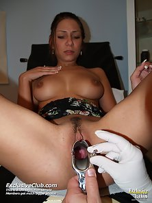 Doctor plays with toys and her brunette pussy