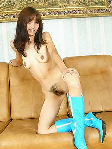 Skinny Brunette Babe in Boots Exposes Her Hairy Vagina