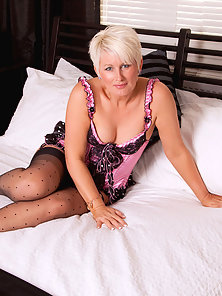 Stockings Wearing MILF Sally Taylor Shows Her Naked Body on Camera