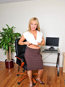 Mature Secretory Stripping and Teasing Herself in Office