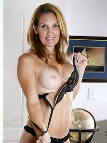 Captain Crystal suddenly feels horny and strips off to show enhanced titties