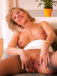 Mature Lady Spreading Legs and Showing Pussy While Lying on Couch