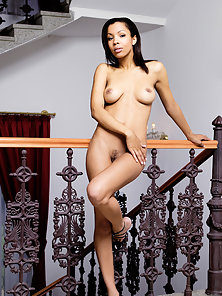Adorable Busty Lady Flashes Her Spread Fanny on Stair Case