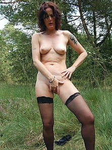 Tattooed MILF Squeezed Her Round Boobs Outdoors