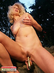 Blonde Mature Puts Huge Dildo in Her Tight Muff