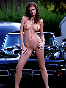 Puffy Boobs Brunette Babe Posing in Front of Vehicle on Cam