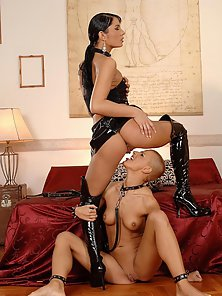 Latex lesbian babes love to lick each other's twats
