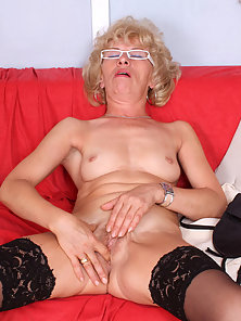 Blonde Lady Masturbating Herself by Spreading Legs on Couch