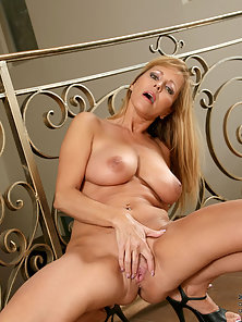 Busty Mature Babe Fondle Shaved Muff by Herself