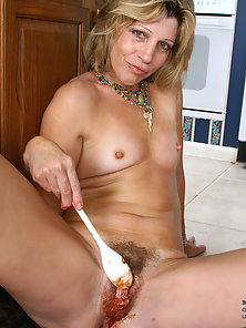 Beautiful Blonde Teasing Her Pussy Using Spoon for Orgasm