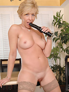 Stockings Wearing MILF Chanel Puts Huge Dildo in Her Twat