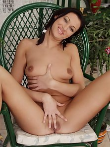 Pigtail Brunette Chick Fingering Her Pink Cunt on Chair