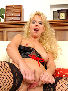 Sultry Blonde Vixen Pinches Her Pale Pink Nipples