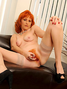 Mature Lady Dildoing Her Hairy Pussy to Get Unlimited Pleasure