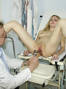 Small tits blonde examines her pussy with instruments