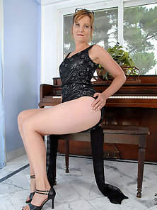 Mature Lady Exposing Goods for Photoshoot Inside Room