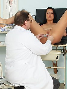Experienced doctor examines her wet brunette pussy