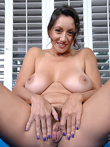 Mature Lady Showing Naked Sexual Parts by Spreading Legs