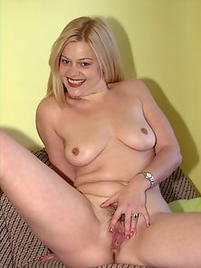 Busty Blonde Female Squeezing and Fingering on Couch