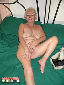 Blonde Granny Nakedly Laying on Floor with Showing Hot Figure