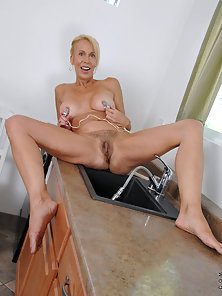 Buxom MILF in Kitchen Showering Her Juicy Hairy Beaver
