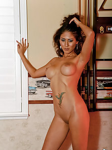Ayanna getting totally nude showing fake thai boobs