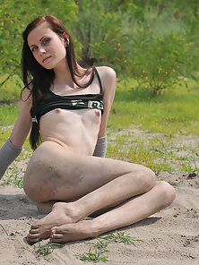 Redhead teen showing her hot body outdoors
