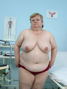 Fatty Lady Squeezed Her Huge Bosoms on Camera