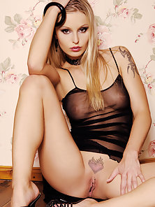 Tattooed Blonde Liliane Flashes Her Attractive Slim Figure in Transparent Dress
