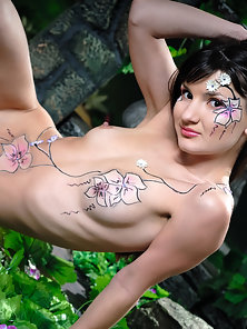 Tattooed Brunette Posing Naked in Nature
