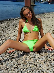 Gorgeous Teen Strips Her Bikini to Show Her Nude Tanned Body with Beautiful Pussy