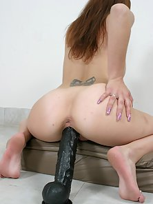 Tattooed Babe Vanessa Pounding Her Cunt with Big Black Dildo