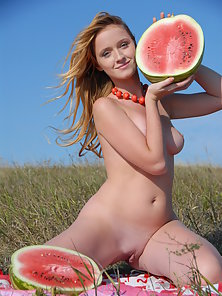 Girl in Naked Giving Pose Outdoors with Holding Watermelon