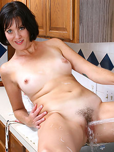Mature Brunette Playing Nakedly in Kitchen through Pissing