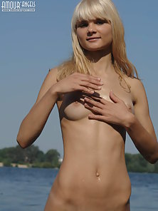 Blonde Teen Shows Assets on Webcam with Log