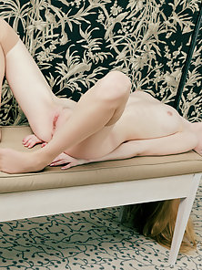 Adorable Blonde Chick Exposes Her Skinny Bare Body with Pink Fanny on Sofa