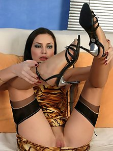 Young Brunette Babe In Black Stockings Loves Solo Masturbation