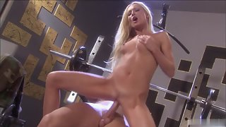 Naughty blonde whore riding dick hard in the gym
