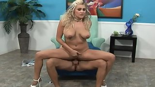 Busty blonde bitch riding a hard monster cock