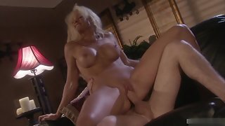 Busty Blonde Getting Fucked by Handsome Man Over Couch