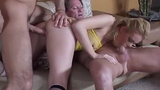 Blonde MILF in stockings gets penetrated by two stiff cocks